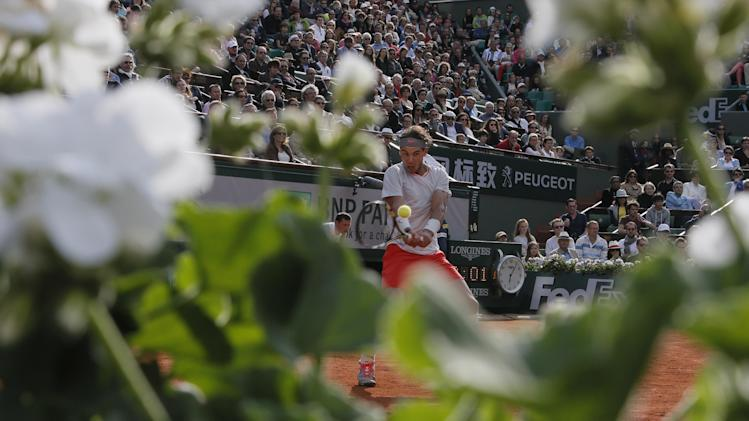 Spain's Rafael Nadal returns against Italy's Fabio Fognini in their third round match at the French Open tennis tournament, at Roland Garros stadium in Paris, Saturday, June 1, 2013. (AP Photo/Michel Spingler)