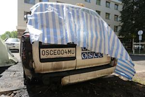 A picture taken on August 9, 2015 shows a burnt vehicle…