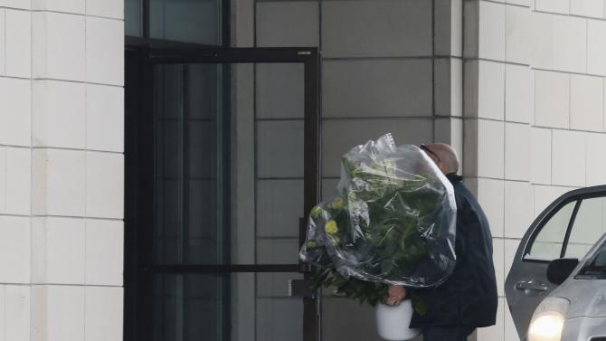 Flowers are brought to the funeral home prior to the visitation for Vito Rizzuto in Montreal