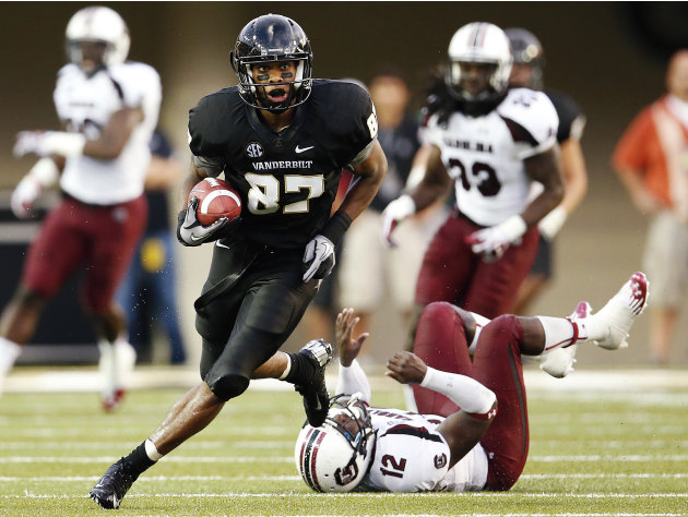 Vanderbilt's Jordan Matthews (87) breaks away from South Carolina's Brison Williams (12) for a touchdown in the first half of an NCAA college football game, Thursday, Aug. 30, 2012, in Nashville, Tenn