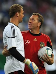 This file photo shows Germany's goalkeeper Manuel Neuer (L) chatting with the team's goalkeeping coach Andreas Koepke, in 2011. Ahead of Thursday's semi-final against Italy, Kopke says Germany will not be taking too many spot-kicks to prepare for a dreaded penalty shoot-out