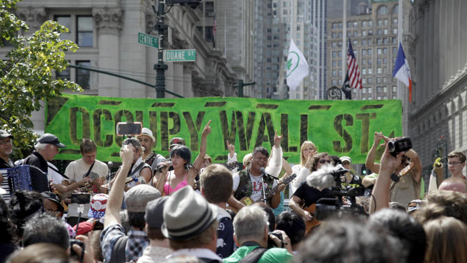 People listen to an Occupy Wall Street anniversary concert in Foley Square in New York on Sunday, Sept. 16, 2012. The Occupy Wall Street movement will mark its first anniversary on Monday. (AP Photo/Seth Wenig)