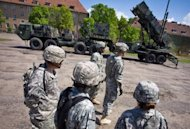 File photo shows US soldiers standing near a Patriot missile battery at an army base in the northern Polish town of Morag. Turkey, Romania, Poland and Spain have all agreed to host US military assets as part of the missile defense shield in Europe