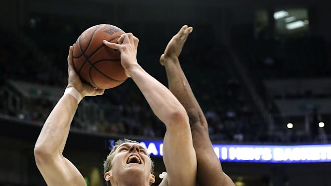 New Mexico's Cameron Bairstow (41) shoots as Harvard's Steve Moundou-Missi (14) defends in the first half during a second-round game in the NCAA college basketball tournament in Salt Lake City, Thursday, March 21, 2013. (AP Photo/Rick Bowmer)