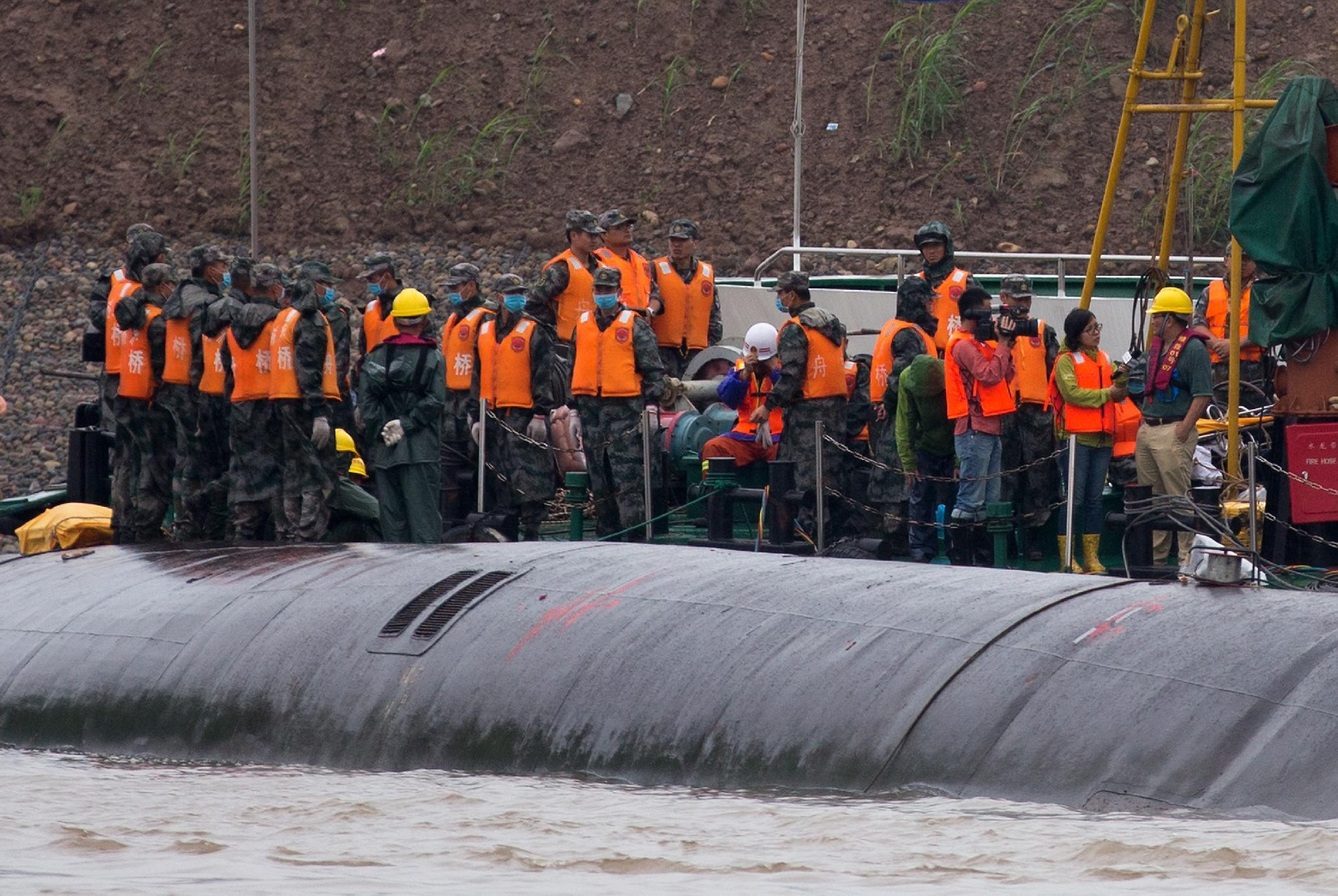 China escalates effort to recover missing from capsized ship