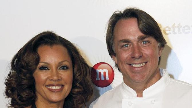 "IMAGE DISTRIBUTED FOR MARS CHOCOLATE NORTH AMERICA - Vanessa Williams, voice of the sixth M&M'S character, Ms. Brown, and New Orleans chef John Besh seen at the ""Better With M"" Kick-Off Event on Thursday, Jan. 31, 2013 in New Orleans. The event featured a three-course chocolate-fueled dinning experience created by John Besh, and a rare, live performance from multi-award winning performer Vanessa Williams. (Jonathan Bachman / AP Images for Mars Chocolate North America)"