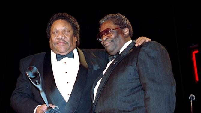 """FILE - In this Jan. 15, 1992, file photo, Bobby """"Blue"""" Bland, left, receives his award for the Rock and Roll Hall of Fame from B.B. King during induction ceremonies in New York. Bland's son Rodd said his father died Sunday, June 23, 2013, at his Memphis home surrounded by relatives. He was 83. (AP Photo/Mark Lennihan, File)"""