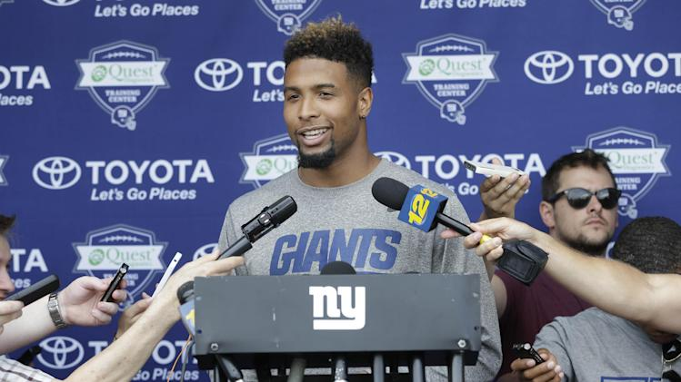 New York Giants' Odell Beckham Jr. talks to reporters before NFL football training camp in East Rutherford, N.J., Tuesday, July 22, 2014