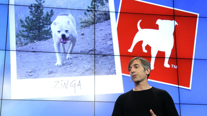 FILE - In this Tuesday, June 26, 2012, file photo, Zynga CEO Mark Pincus talks about the Zynga logo during an announcement at Zynga headquarters in San Francisco. Online game maker Zynga reported on Tuesday, Feb. 5, 2013,  a smaller net loss and nearly flat revenue for the fourth quarter of 2012, a year in which its stock price shrank 75 percent. (AP Photo/Paul Sakuma)