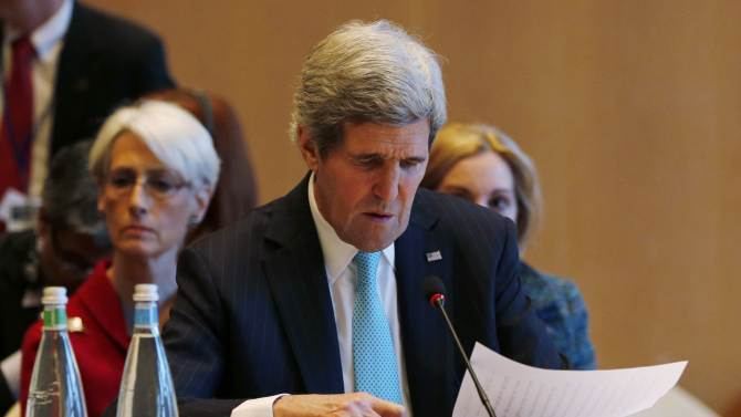 U.S. Secretary of State John Kerry looks at his notes at the opening of the Geneva-2 peace conference in Montreux