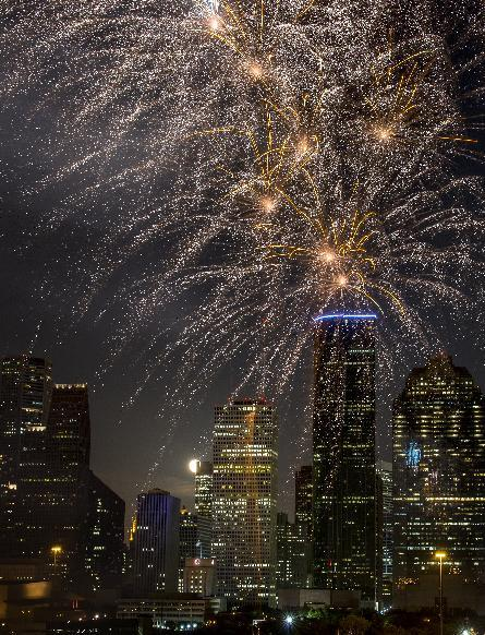 Fireworks light up the sky during the Freedom Over Texas annual Fourth of July celebration on Wednesday, July 4, 2012, in Houston. (AP Photo/Houston Chronicle, Smiley N. Pool)