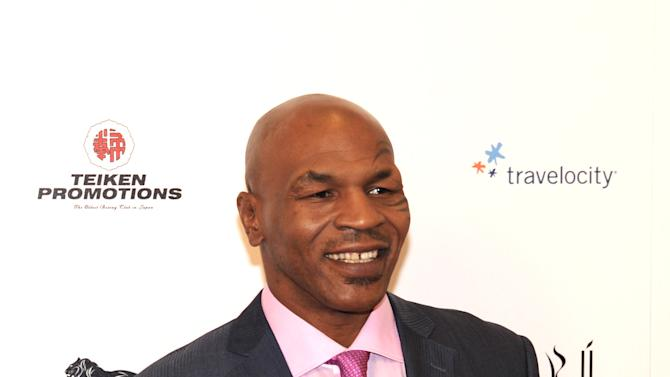 "In this photo provided by the Las Vegas News Bureau,  ""Iron"" Mike arrives on the red carpet for the ""Mike Tyson: Undisputed Truth-Live on Stage"" grand opening show at the MGM Grand Hotel & Casino on the Las Vegas Strip. Saturday, April 14, 2012. (AP Photo/Las Vegas News Bureau, Glenn Pinkerton)"