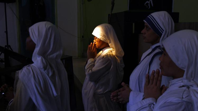Catholic nuns from Missionaries of Charity attend a Good Friday prayer at a church in Kolkata