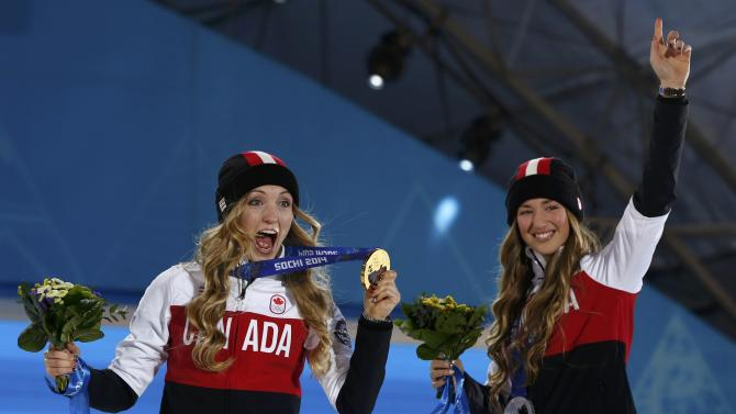 Medalists pose during the medal ceremony for the women's freestyle skiing moguls at the Sochi 2014 Sochi Winter Olympics
