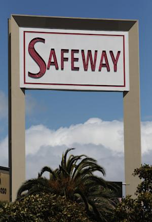 This Thursday, April 26, 2012, file photo, shows the exterior of a Safeway store in San Francisco. Safeway Inc. said Thursday, July 19, 2012, that its net income fell 16 percent in the second quarter, as the grocery store operator spent more on advertising and fought to hold onto customers amid growing competition. (AP Photo/Paul Sakuma, File)