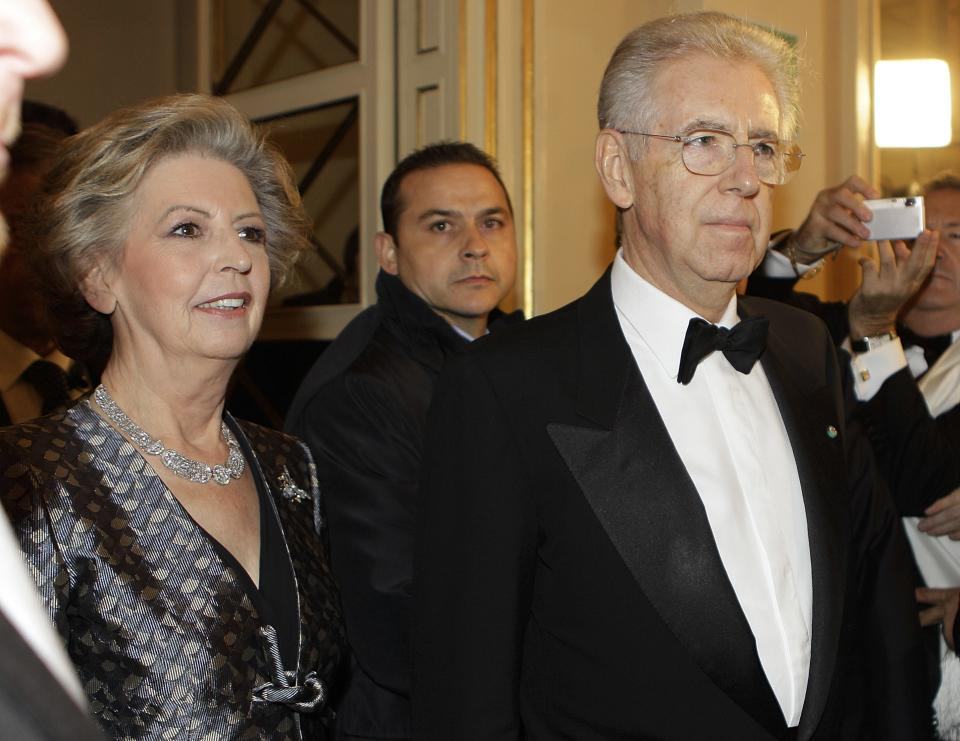Italian premier Mario Monti and his wife Elsa arrive at Milan's La Scala theater, Italy, Wednesday, Dec. 7, 2011. Mozart's Don Giovanni, led by director Daniel Baremboin, will inaugurate the Milan's opera house season Wednesday. (AP Photo/Luca Bruno)