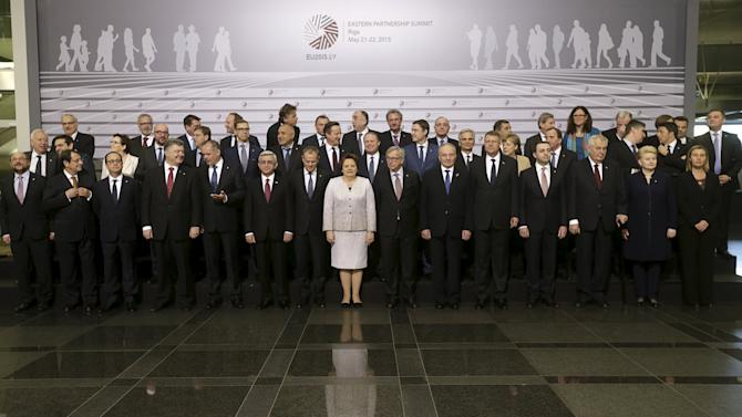 Heads of states and European Union officials pose for a picture before the Eastern Partnership Summit session in Riga