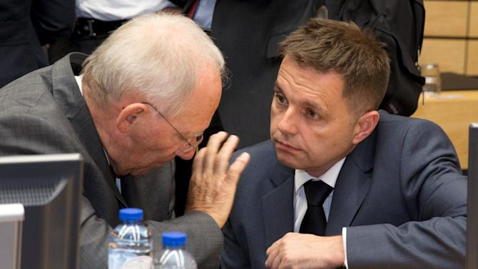 Slovakia's Finance Minister Kazimir speaks with German Finance Minister Schaeuble at a Eurozone finance ministers meeting on the situation in Greece in Brussels