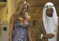 FILE - In this May 1, 2012 file photo, Israeli model Bar Refaeli plays a seductress with actor Tomer Sisley on a set of a film made about the assassination of Hamas operative Mahmoud al-Mabhouh, in Eilat, southern Israel. The family of al- Mabhouh says it wants to block the release of a movie being made about his 2010 assassination in a Dubai hotel. The killing of Mahmoud al-Mabhouh was widely blamed on Israel's Mossad spy agency. (AP Photo/Dan Balilty, Files)