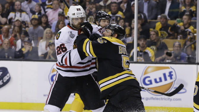 Boston Bruins defenseman Johnny Boychuk (55) stands up against Chicago Blackhawks center Michal Handzus (26), of Slovakia, and during the first period in Game 3 of the NHL hockey Stanley Cup Finals in Boston, Monday, June 17, 2013. (AP Photo/Elise Amendola)