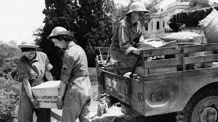 FILE- In this Sept. 11, 1943, file photo, Women Army Corps (WAC) soldiers unload supplies somewhere in North Africa. (AP Photo, File)