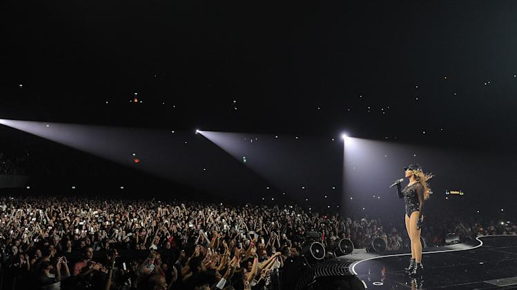 "Singer Beyonce performs on her ""Mrs. Carter Show World Tour 2013"", on Monday, April 22, 2013 at the Ziggo Dome in Amsterdam, Netherlands. Beyonce is wearing a custom hand beaded one-piece by Givenchey. (Photo by Frank Micelotta/Invision for Parkwood Entertainment/AP Images.Singer Beyonce performs on her ""Mrs. Carter Show World Tour 2013"", on Monday, April 22, 2013 at the Ziggo Dome in Amsterdam, Netherlands.Beyonce is wearing a leather coat and boots by Pucci.  (Photo by Frank Micelotta/Invision for Parkwood Entertainment/AP Images."