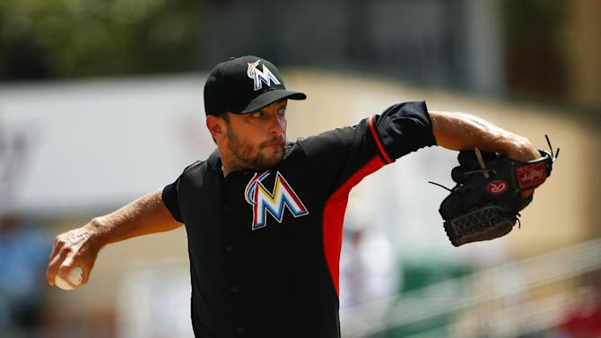 Miami Marlins starting pitcher Jarred Cosart (23) works in the first inning of an exhibition spring training baseball game against the Washington Nationals Wednesday, April 1, 2015, in Jupiter, Fla. (AP Photo/John Bazemore)
