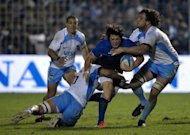 France's scrum half Maxime Machenaud (C) is tackled by Argentinian Pumas' flanker Tomas De la Vega (L) and lock Esteban Lozada during their rugby union Test match at Jose Fierro stadium in Tucuman, Argentina, on June 23. France won 49-10