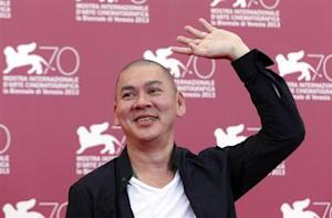 "Director Ming-Liang, poses during a photocall for the movie ""Stray Dogs"", directed by him, during a photocall for the movie ""Stray Dogs"" during the 70th Venice Film Festival in Venice"