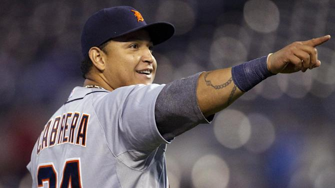 Detroit Tigers third baseman Miguel Cabrera (24) points to the crowd following a baseball game against the Kansas City Royals at Kauffman Stadium in Kansas City, Mo., Monday, Oct. 1, 2012. The Tigers defeated the Royals 6-3 and clinched the AL Central title. (AP Photo/Orlin Wagner)