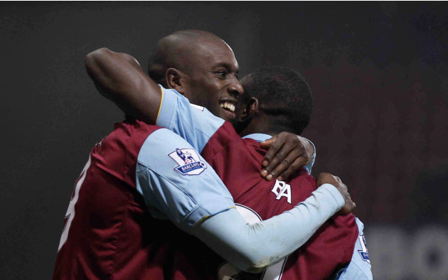 West Ham's Carlton Cole, left, celebrates his first goal with Demba Ba during the English FA Cup fifth round soccer match between West Ham and Burnley at Upton Park stadium in London, Monday, Feb. 21,