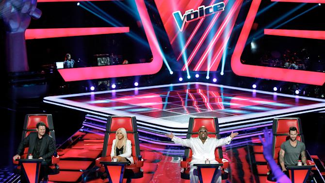 """This June 2012 photo released by NBC shows mentors, from left, Blake Shelton, Christina Aguilera, Cee Lo Green and Adam Levine on the set of """"The Voice,"""" in Los Angeles. The contest between """"The Voice"""" and """"The X Factor"""" is escalating after NBC scheduled its """"Voice"""" against Wednesday's second-season debut of Fox's """"X Factor."""" (AP Photo/NBC, Tyler Golden)"""