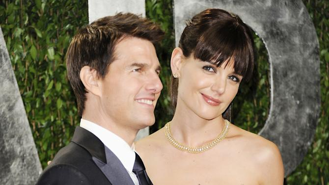 FILE - This Feb. 26, 2012 file photo shows actors Tom Cruise, left, and his wife Katie Holmes at the Vanity Fair Oscar party in West Hollywood, Calif.   At just 33, Holmes is emerging from the public hysteria of her relationship with Cruise with open roads ahead, and, possibly, renewed ambition. (AP Photo/Evan Agostini, file)