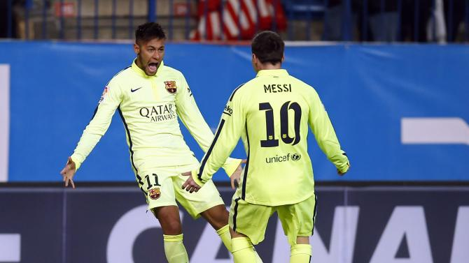 Barcelona's Neymar celebrates next to team mate Lionel Messi after scoring a goal against Atletico Madrid during their Spanish King's Cup quarterfinal second leg soccer match in Madrid