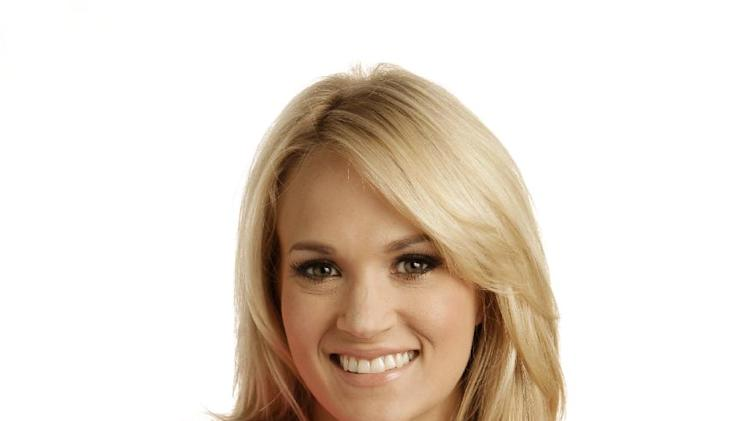"This April 19, 2012 photo shows Carrie Underwood in Nashville, Tenn. Underwood's latest release ""Blown Away,"" was released Tuesday, May 1. (AP Photo/Mark Humphrey)"
