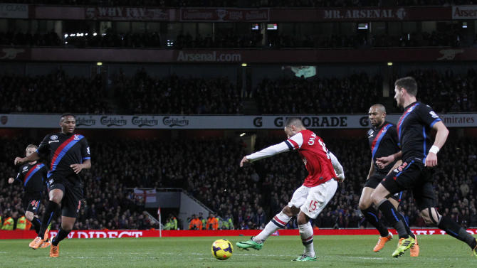 Arsenal's Alex Oxlade-Chamberlain, third right, scores his second goal against Crystal Palace during their English Premier League soccer match at Emirates Stadium in London, Sunday, Feb. 2, 2014. (AP Photo/Sang Tan)