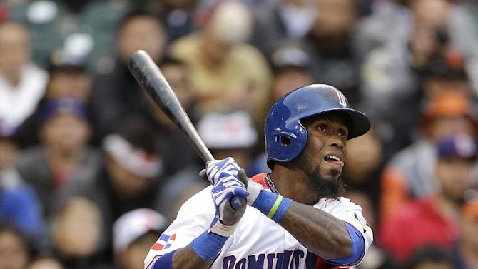 The Dominican Republic's Jose Reyes (7) doubles off of Puerto Rico's Giancarlo Alvarado during the first inning of the final game of the World Baseball Classic in San Francisco, Tuesday, March 19, 2013. (AP Photo/Eric Risberg)