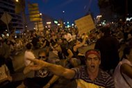 "<p>Thousands of Spanish ""indignant"" protesters rallied against austerity cuts Friday night before some of them clashed with police, who charged demonstrators with batons.</p>"