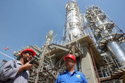 <p>Iraqi workers stand outside the second refinery for crude oil in the Al-Dora refinery complex during its official opening ceremony in Baghdad in September 2010. Iraq's oil exports reached their highest level in more than three decades last month as the country's output has continued to increase, oil ministy officials said.</p>