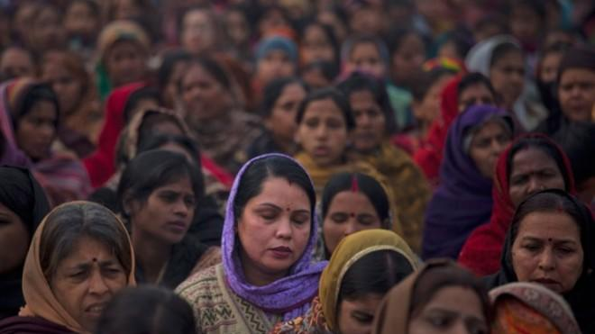 Indian women offer prayers for a gang rape victim during a memorial service on Jan. 2, in New Delhi.