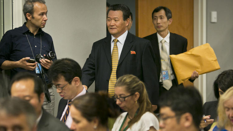Sin Son Ho, Permanent Representative for North Korea to the U.N., arrive for a press conference on Friday, June 21, 2013 at U.N. headquarters in New York. (AP Photo/Bebeto Matthews)