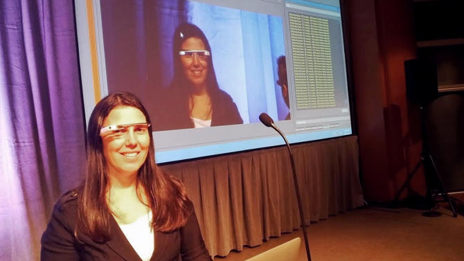 This undated photo released courtesy Cecilia Abadie shows Cecilia Abadie a software developer from Temecula, Calif., during a presentation. Abadie was pulled over for speeding on Tuesday Oct. 29, 2013, in San Diego, when a California Highway Patrol officer noticed she was wearing Google Glass and tacked on a citation usually given to drivers who may be distracted by a video or TV screen. (AP Photo/Courtesy Cecilia Abadie)