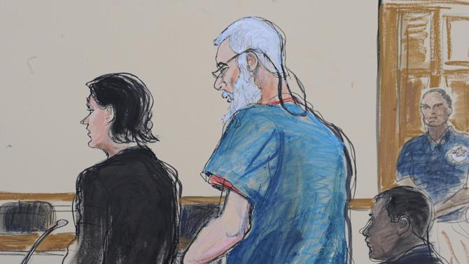 In this courtroom drawing, defense attorneys Sabrina Shroff and Jerrod Thompson Hicks represent accused terrorist Abu Hamza al- Masri, center, before magistrate judge Franklin Maas in Manhattan federal court, Saturday, Oct. 6, 2012, in New York. Abu Hamza al-Masri, entered no plea to charges of conspiring with Seattle men to set up a terrorist training camp in Oregon and of helping abduct 16 hostages, two of them American tourists, in Yemen in 1998. (AP Photo/Elizabeth Williams)