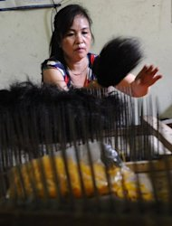 A woman is seen sorting hair at a family hair workshop in Binh An village, in the northern province of Bac Ninh. The traditional farming area has been transformed due to the sale of hair, which has become big business globally. Exports of Vietnamese locks sustain some 500 families -- or 80 percent of the population in this area