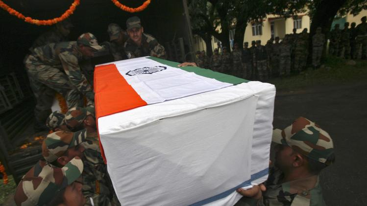 Indian Army soldiers carry a coffin during a wreath laying ceremony on outskirts of Jammu