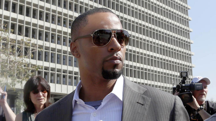 FILE - In this Feb. 14, 2014, file photo, former NFL safety Darren Sharper leaves a courthouse in Los Angeles. Former NFL All-Pro safety Darren Sharper returns to court Thursday March 13, 2014 for a hearing that will determine whether he's released on bail amid new charges that he drugged and sexually assaulted two women last year in Arizona. (AP Photo/Nick Ut )