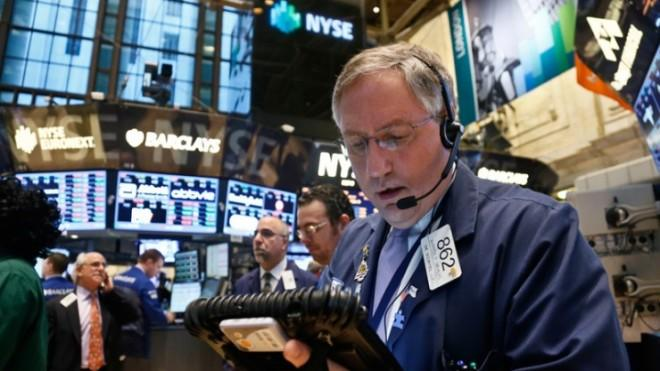 A trader monitors activity from his mobile workstation at the New York Stock Exchange on Feb. 20.
