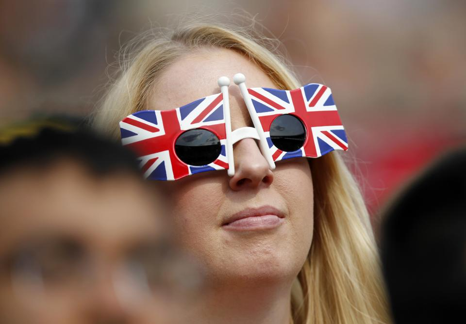 A member of the public wearing sunglasses featuring the British flag watches Andy Murray of Britain face Lu Yen-Hsun of Taiwan in a Men's second round singles match at the All England Lawn Tennis Championships in Wimbledon, London, Wednesday, June 26, 2013. (AP Photo/Sang Tan)