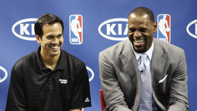 """Miami Heat head coach Erik Spoelstra, left, and LeBron James laugh during a ceremony to present James with the NBA MVP trophy, Saturday, May 12, 2012, in Miami. Calling the honor """"overwhelming"""" but pointing to a """"bigger goal,"""" James on Saturday became the eighth player in NBA history to win the MVP award three times. (AP Photo/Wilfredo Lee)"""