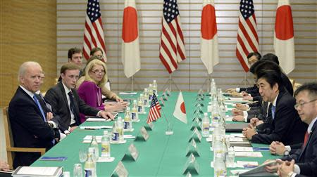 Japanese Prime Minister Shinzo Abe speaks during a meeting with U.S. Vice President Joe Biden at Abe's official residence in Tokyo